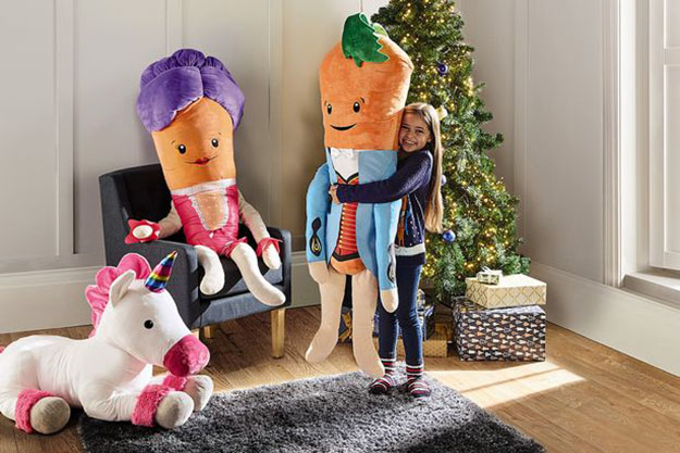 child hugging the kevin the carrot toy