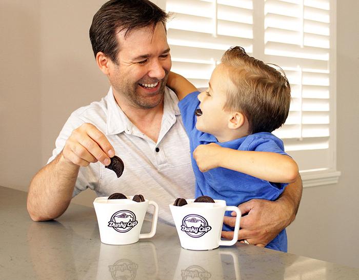 dunking cookies into milk plastic mug