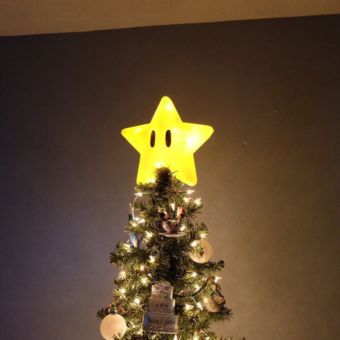 large super mario power star tree topper on a tree