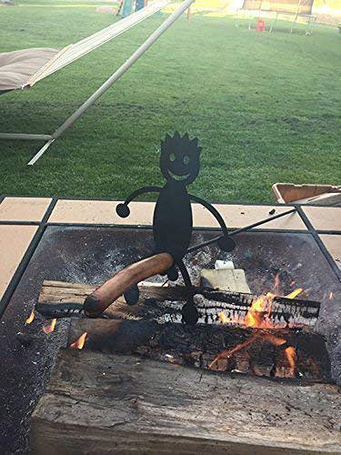 naughty campfire roasting stick man hotdog