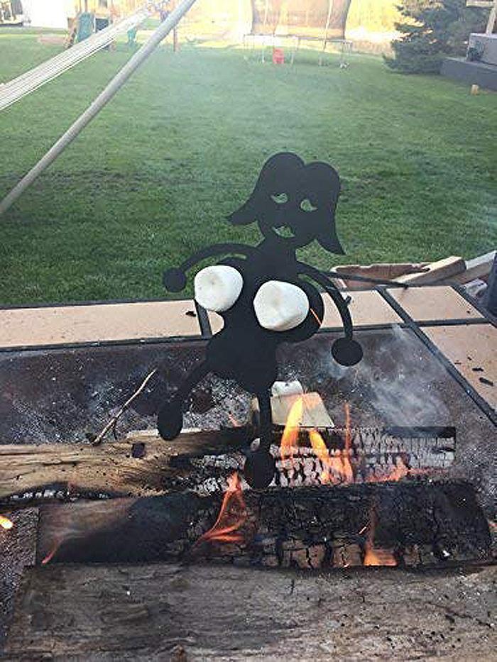 naughty campfire roasting stick woman marshmallows