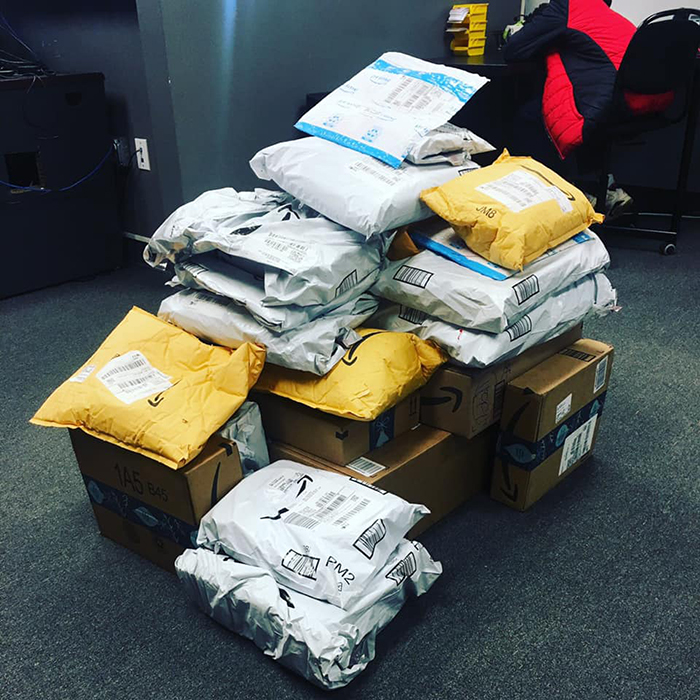 A pile of packages from Kristen Bell fans arrive for Emily