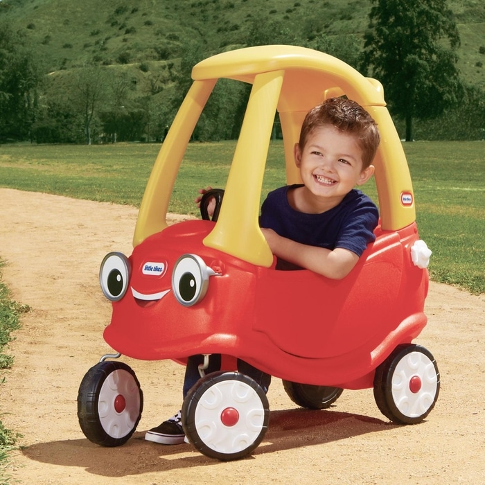 Boy in a Cozy Coupe