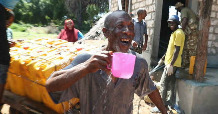 Kenyan Man Happy Drinking His Cup of Water
