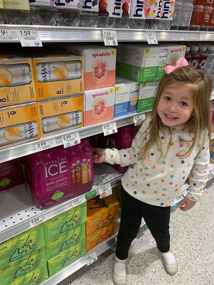 Kristina Watts Daughter Emmie at a Grocery's Sparkling Water Section
