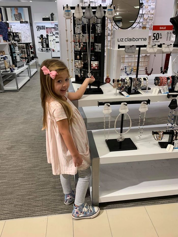 Kristina Watts Daughter Emmie at a Mall's Accessories Section