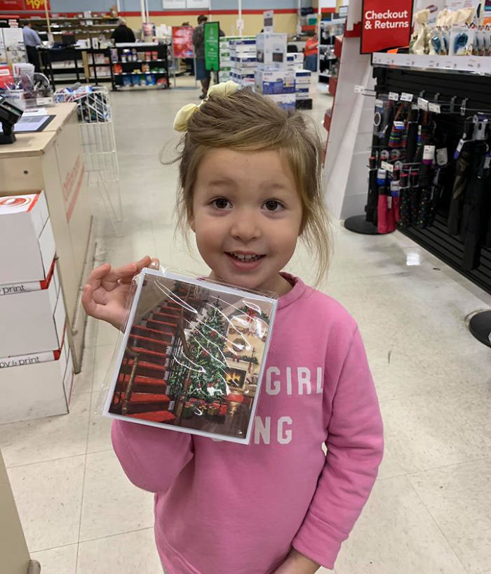 Kristina Watts Daughter Emmie with Christmas Tree Photo