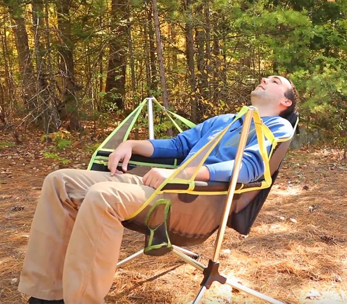 Man Sitting on a Nemo Reclining Camping Chair in the Woods