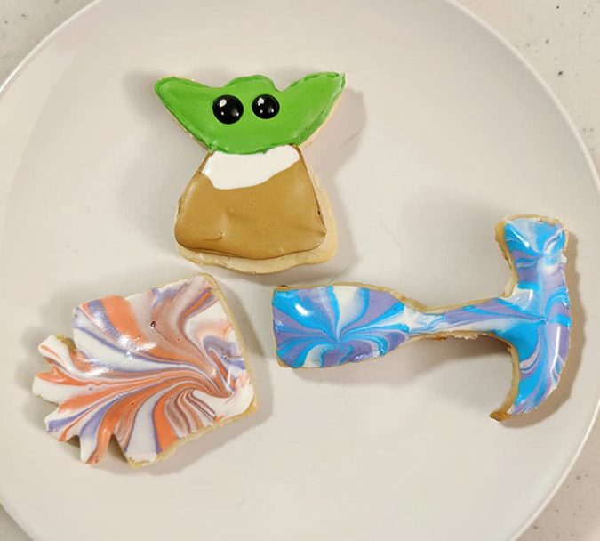 baby yoda cookie with gift and hammer cookies