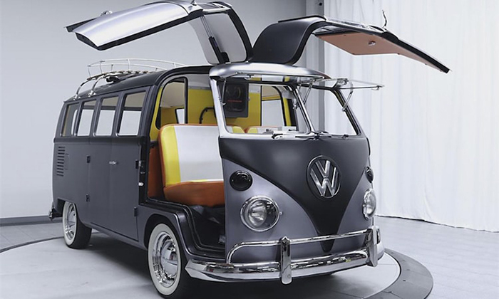 custom VW bus with its gull-wing type doors lifted
