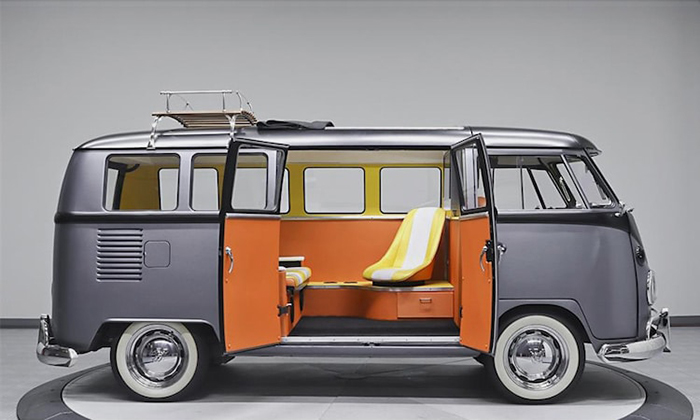 custom VW bus with sleek gray exterior and colorful interior
