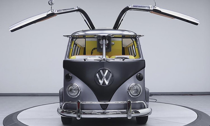 front-facing custom VW bus with lifted gull-wing doors