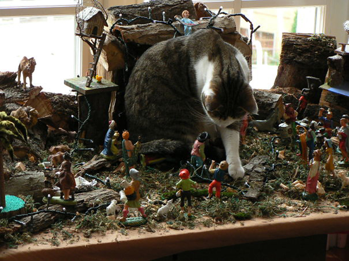 pets destroying christmas tyrannosaurus
