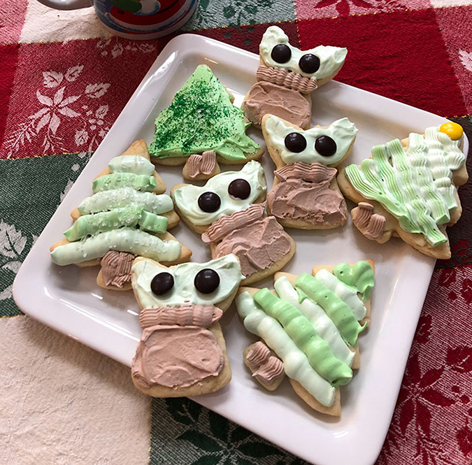 baby yoda cookies with christmas tree-shaped cookies