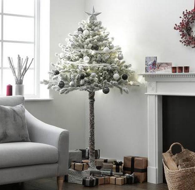 snowy half christmas tree