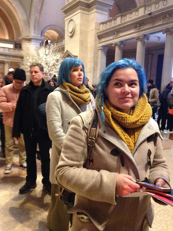 two ladies with blue hair and cream coats at the met