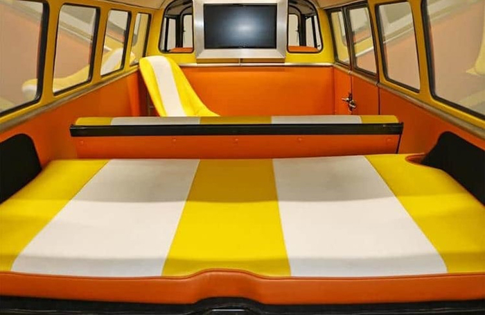 yellow and orange interior of the custom VW bus