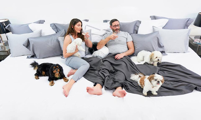 Couple with Four Dogs on Ace Collection 12-foot Bed