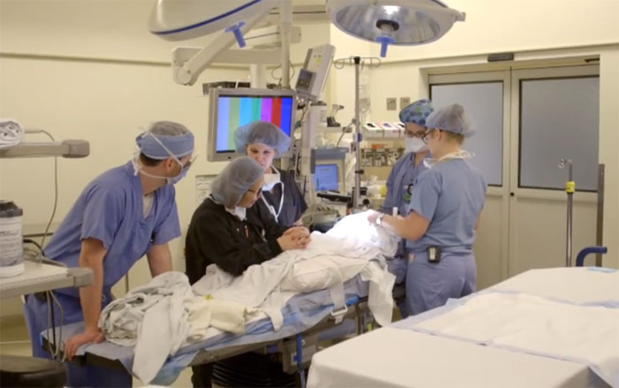 Dr. Robert Parry and his colleagues in the operating theatre