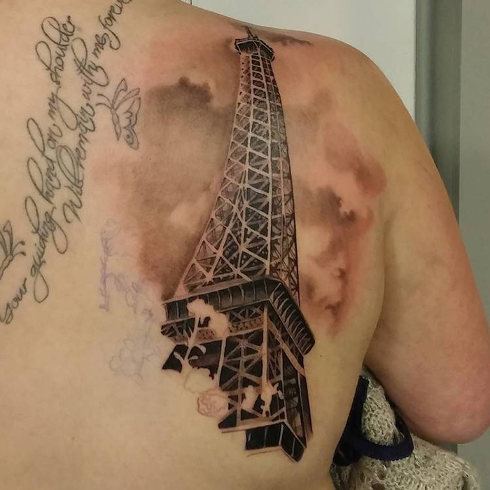 Eiffel Tower with Clouds Tattoo on Back