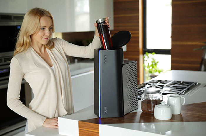 Lady Using Juno to Cool Coffee in a Tumbler