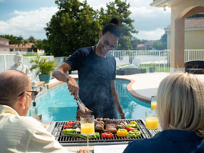 Man Grilling Steak
