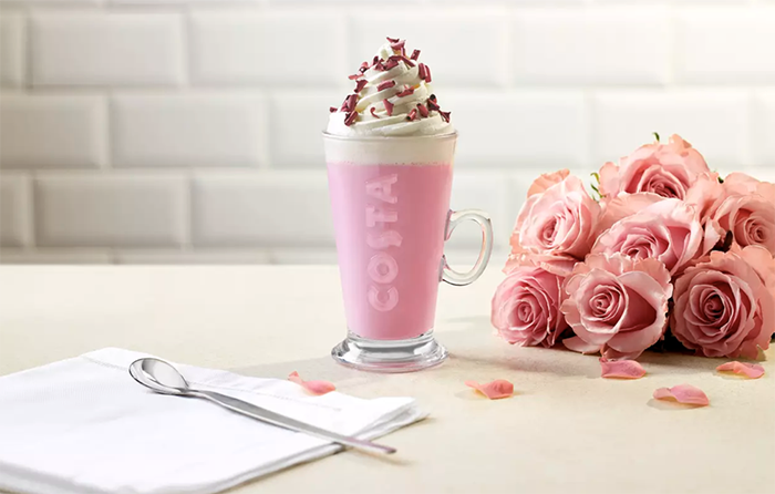 Ruby Cocoa Hot Chocolate with a bouquet of delicate pink roses