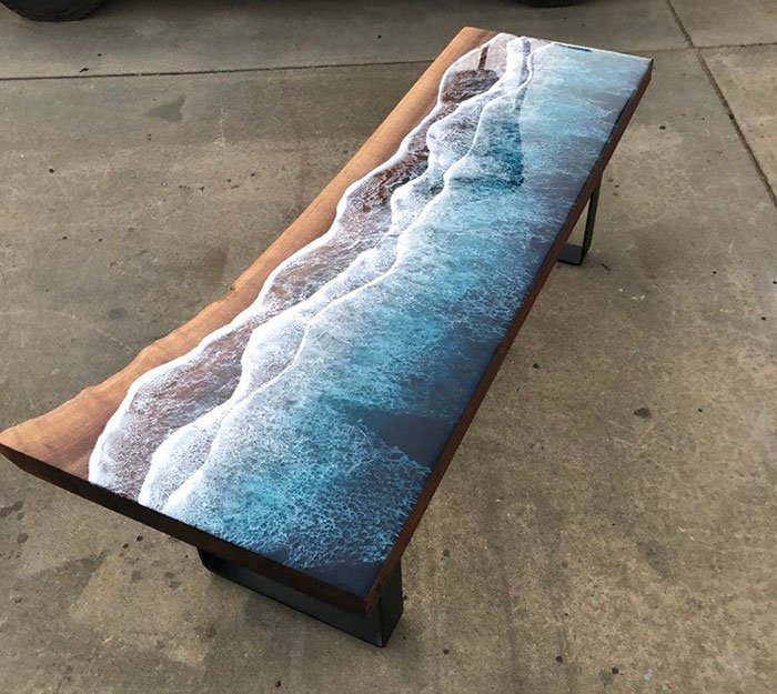 a strip of natural wood is left to resemble the beach on this table