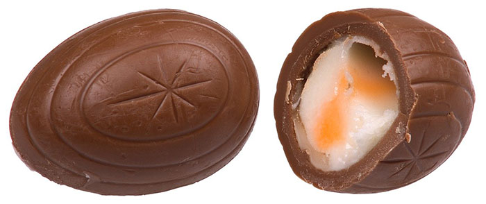 a whole creme egg and one cut in half