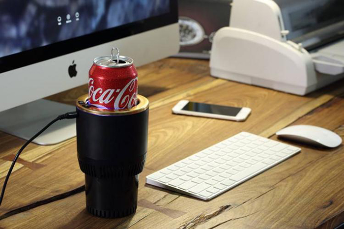black and gold car cup holder placed on desk