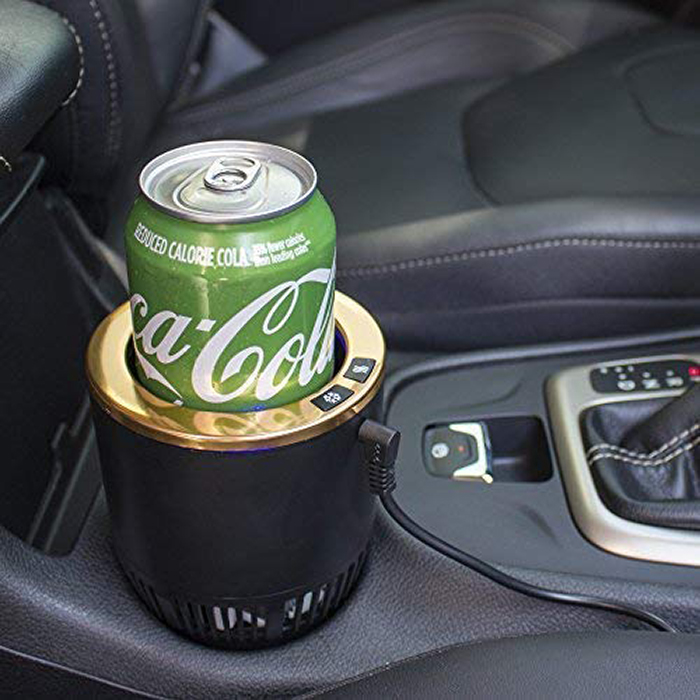 black and gold cup holder with a green coca cola can