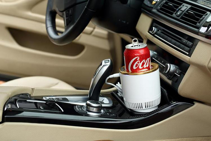 car cup holder with soda can in the front
