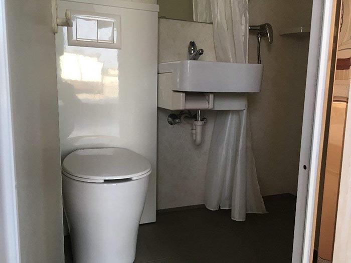 expanding tiny home bathroom fixtures
