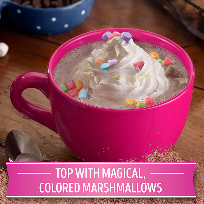 hot cocoa topped with a swirl of whipped cream and colorful marshmallows
