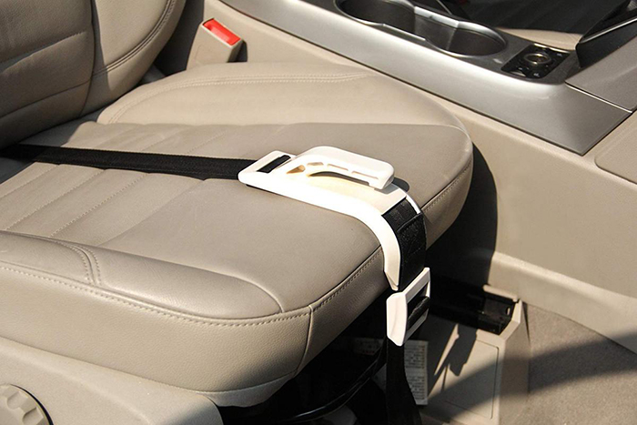installed pregnancy car seat belt with white fastening attachment