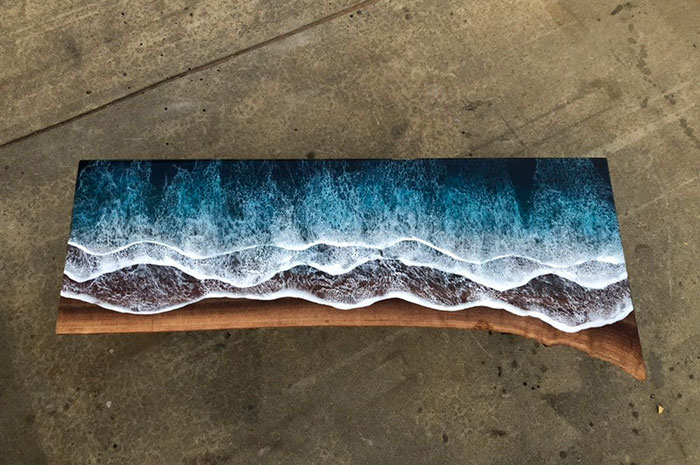 live edge wood furniture with ocean wave resin design