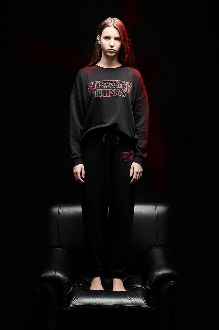 model wearing black stranger things sleepwear set