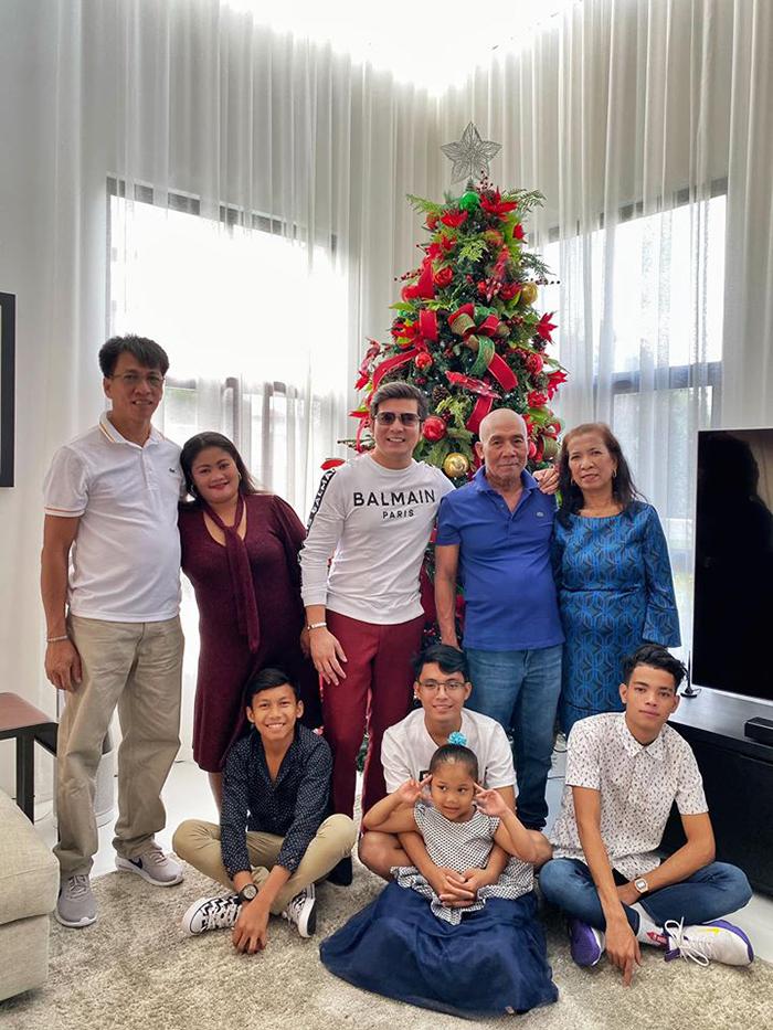 successful man gives adoptive family mansion