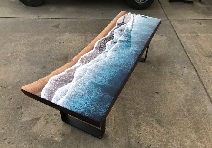 table resembles a slice of ocean and beach