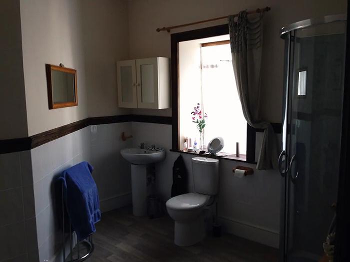 the open book apartment bathroom
