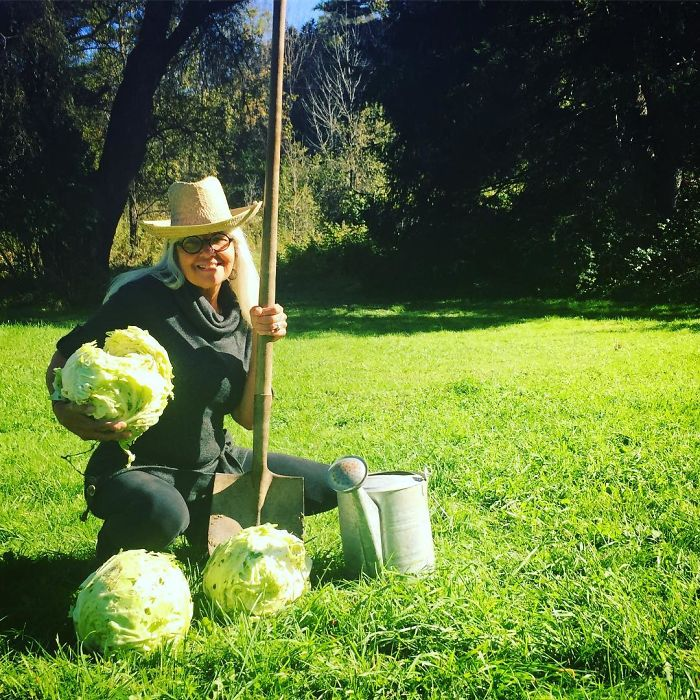 woman displays cabbages