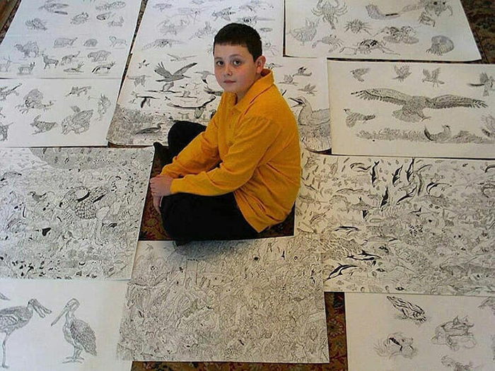 Dusan Krtolica sits surrounded by his incredible animal drawings