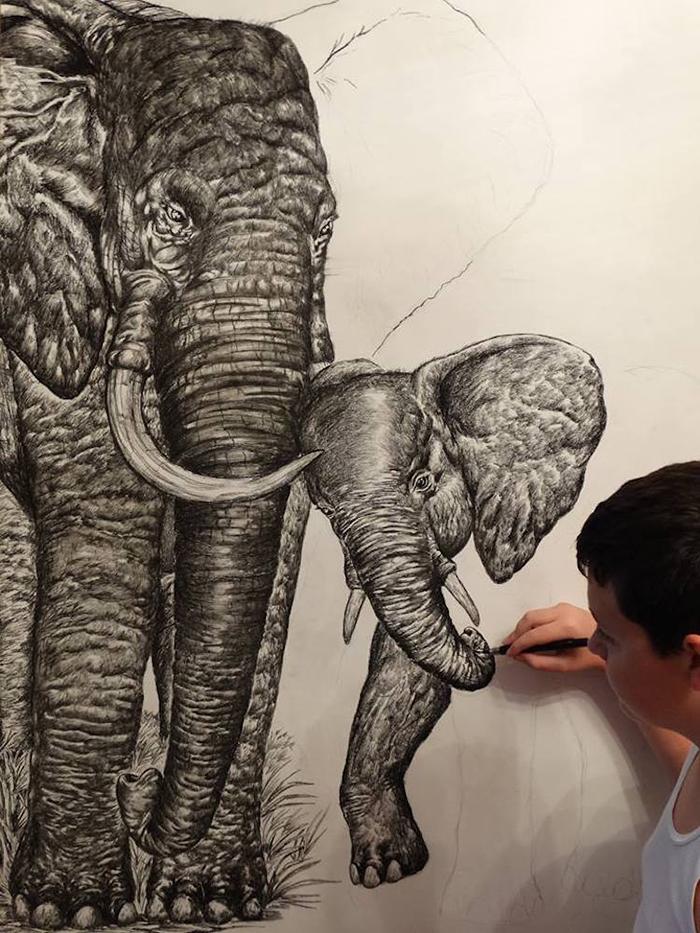 Dusan drawing a portrait of elephants
