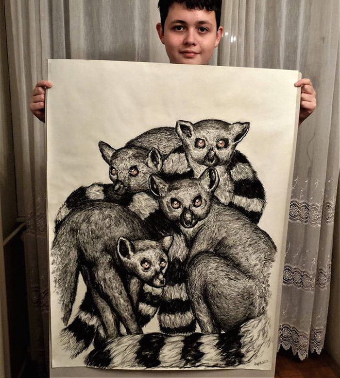 Dusan holds up his drawing of lemurs