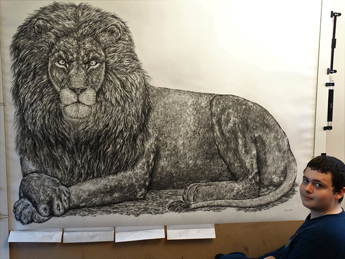 Dusan poses with his largest animal drawing