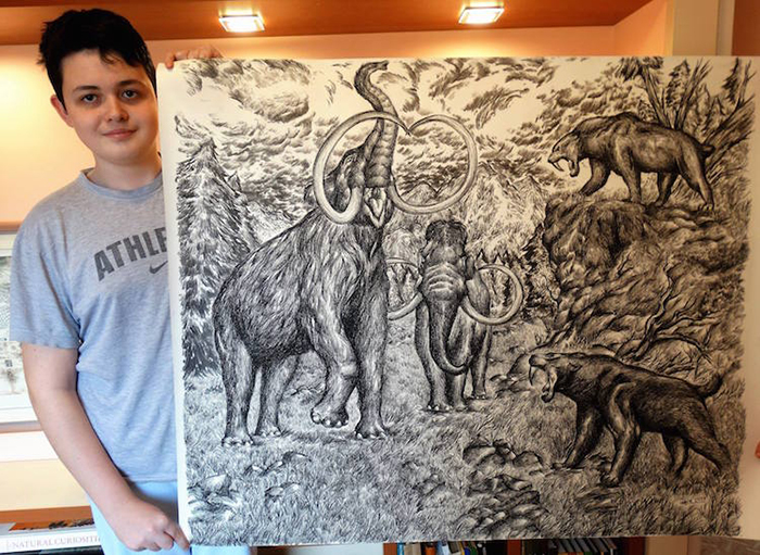 Dusan shows off his illustration of prehistoric animals
