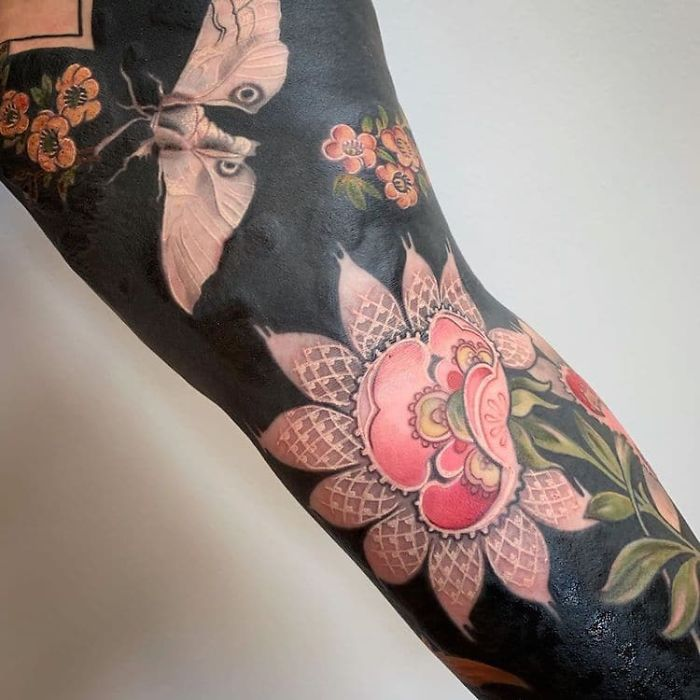 Flowers and Moth Blackout Tattoo by Esther Garcia