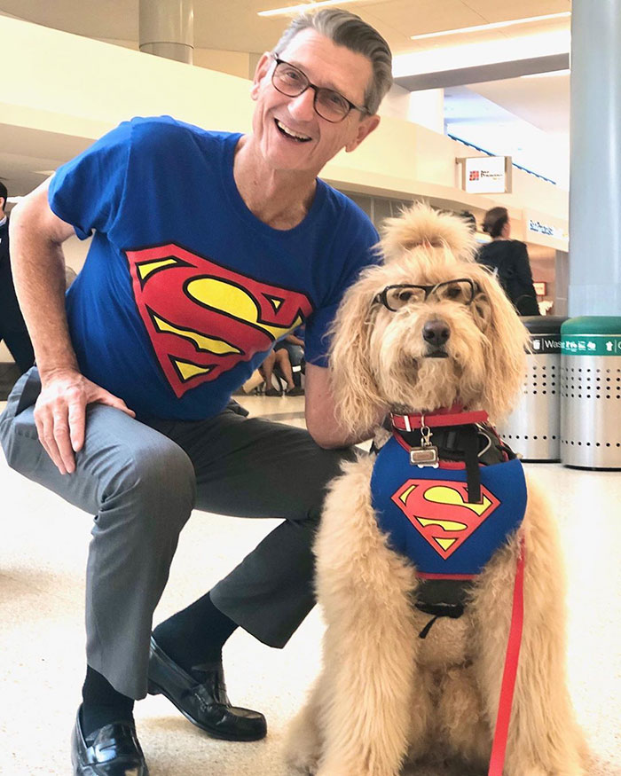 Man in Matching Superman Shirt with a Wag Brigade Dog Member