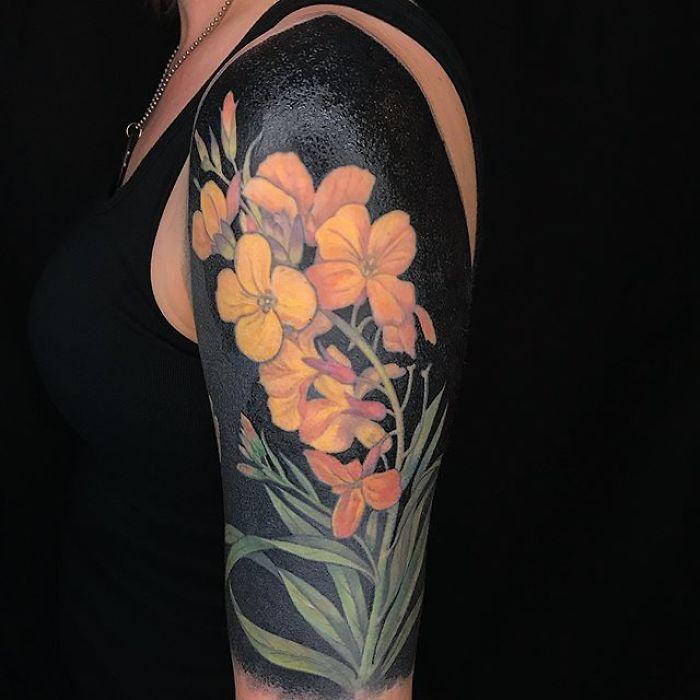 Orange Flowers Blackout Tattoo by Esther Garcia