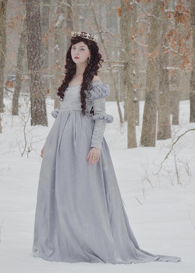 angela clayton in a powder blue dress in winter